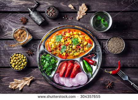 stock-photo-indian-mutter-paneer-dish-with-spices-on-the-wooden-background-304357655