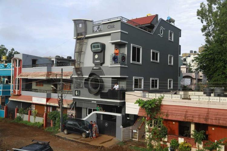 casa a forma di macchina fotografica
